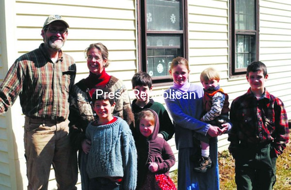 The Ives family (from left): Steve and Julie pose with their children — (front) Daniel and Hazel, (back) Elijah, Hannah holding Zadock and Noah.<br><br>(Staff Photo/Robin Caudell)