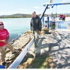 Ticonderoga Ferry owner Michael Matot (left) and Ferry Capt. Terry Norris work at tightening the underwater cable the ferry runs on so it can open this week. The ferry runs between Ticonderoga and Shoreham, Vt., and is the only independent ferry on Lake Champlain. <br><br>(Staff Photo/Lohr McKinstry)