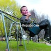 James Sherman (above), 18, of Plattsburgh launches himself into the air off a ramp in the skateboard park at Melissa L. Penfield Park in Plattsburgh Sunday. Dylan Williams (left), 9, of Plattsburgh enjoys an afternoon swinging on the swingset. Many people took advantage of Sunday's mild weather to get outside and have some fun.<br><br>(P-R Photo/Gabe Dickens)