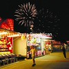 Fireworks light up the sky above the Midway Saturday as the Essex County Fair winds down. Fairs in both Essex and Franklin counties ended Sunday.<br><br>(Staff Photo/Alvin Reiner)