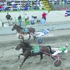 Vacation Journal (3), driven by Kevin Gale, and Swanky Sweetwater (1), with Larry LaPage at the reins, race in an open 2-year-old trot at the Franklin County Fair Wednesday. For results and more harness racing, please see Page B3.<br><br>(P-R Photo/Andrew Wyatt)