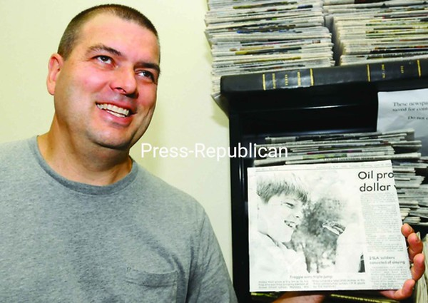 By luck, Bobby Hall found an old press plate in a pile of junk showing a photograph of him when he was about 11 years old holding a frog. It's a picture that has popped up a few times in his life.<br><br>(Staff Photo/Kelli Catana)