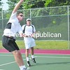 Martin Drolet puts away an overhead winner as partner Richard Gottschall watches during play Saturday in the North Country Tennis Association Doubles Tournament at Plattsburgh High School. Drolet and Gottschall defeated Tristan Parrotte and Patrick Daly, 6-1, 6-0. The three-day tournament concludes today. <br><br>(P-R Photo/ Andrew Wyatt)