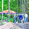 State Police Capt. John Tibbitts (left) talks with police excavating the site in Minerva where June Collard was believed to have been killed 30 years ago. Police found what they believe are part of her remains Tuesday.<br><br>(Staff Photo/Lohr McKinstry)