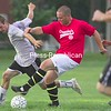 Foster's Nolan Ryan and Ormsby's Well Drilling's Jeff Norton contest the ball during Saturday's championship game in the North Country Men's Soccer League at the Base Oval. Ormsby's got a late goal from Clint McCool for a 3-2 victory.<br><br>(P-R Photo/Gabe Dickens)