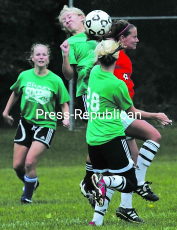 The Green Room's Jessica Ewald and Chazy Giroux's Lindsey Keyser collide while contesting the ball during Sunday's North Country Women's Soccer League championship game. Keyser scored two goals and assisted on three others to help lead Chazy Giroux's to a 6-0 win.<br><br>(P-R Photo/Gabe Dickens)