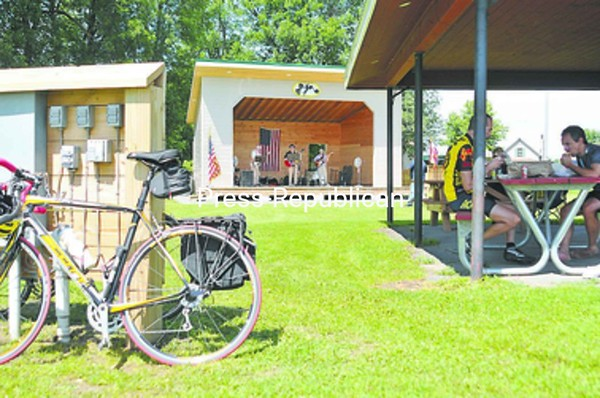 Split Rock performs on the outdoor stage at the Rouses Point Civic Center Thursday afternoon to entertain bikers taking a rest stop as a part of the Velo Quebec Grand Tour. Area residents and tour cyclists enjoyed the harmony-drenched standards played by the band, as well as a performance by vocalist Laura Capito. Lunch was served at the Civic Center for cyclists cruising on their last leg through the North Country.<br><br>(P-R Photo/Andrew Wyatt)