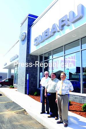 Bill McBride Sr., Brian McBride and  Bill McBride Jr. (left to right) outside the new Subaru dealership.<br><br>(Staff Photo/Kelli Catana)