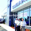Bill McBride Sr., Brian McBride and  Bill McBride Jr. (left to right) outside the new Subaru dealership.<br><br>(Staff Photo/Kelli Catana)