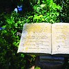 A stone book sits on a pedestal by Sally's Pond, its pages open to a flowery poem. <br><br>(P-R Photo/Sara LoTemplio)