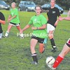 Natalie Buysse (11) of KT Productions stops a chance by Green Room's Kim Dragoon (center) in the North Country Women's Soccer League semifinals. Green Room won 3-1 to reach the final.<br><br>(P-R Photo/Andrew Wylie)