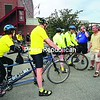 Mayor Clyde Rabideau (right) of Saranac Lake greets some of the tandem bicycle riders before they leave for a tour of the Adirondacks. He estimated the tour brought in about $12,000 to the community during the three days they were in town.<br><br>(P-R Photo/Jack LaDuke)