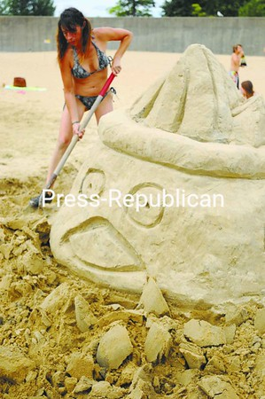 Monica Trudeau creates a fish stuck in a bowl at the Plattsburgh City Beach during the Press-Republican Sand Sculpture Contest.<br><br>(Staff Photo/Kelli Catana)