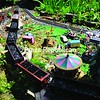 Coal cars travel through a circus with a ferris wheel in Carl and Sally Kokes's backyard garden in Peru. <br><br>(P-R Photo/Sara LoTemplio)