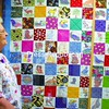 Pat Montroy stands with the quilt she and patients at H. K. Freedman Renal Center made. It hangs there for all to enjoy.<br><br>(P-R Photo/Andrew Wyatt)
