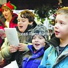 After an escorted hayride through town by the Essex County Sheriff's Department, Cub Scout Pack 5 members Daniel Breault (left to right), Matthew Furnia and Alek Lautenschubtz sing a collection of Christmas carols at Keeseville Country Gardens Sunday afternoon. This is the second year caroling for Pack 5, which has been together for four years and serves boys in grades one through five in and around Keeseville.<br><br>(P-R Photo/Gabe Dickens)