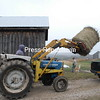 Scott Thew loads a large round bale of hay to be used to feed horses into the bed of a truck on his farm in Harkness.<br><br>(P-R Photo/Joanne Kennedy)