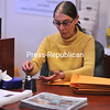 Suzanne Hand prepares mailers for the Clinton County Office for the Aging in Plattsburgh. Following a career in the customer-service field, Suzanne has found a new professional home there.<br><br>(P-R Photo/Andrew Wyatt)