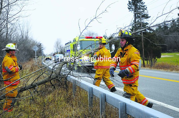 Emergency responders from South Plattsburgh Fire Department work to clear a portion of Route 9 near Bluff Point after a tree fell Monday and blocked the roadway. The tree damaged some cars when it fell. No further information was available Monday.<br><br>(Staff Photo/Kelli Catana)