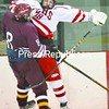 Troy Labelle (left) of Burnt Hills and Dolan Riley of Saranac Lake collide while chasing the puck in the second period.<br><br>(P-R Photo/Pat Hendrick)