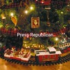 A toy model train circles underneath the Christmas tree, giving the room an old-fashioned appeal. The Kent-Delord museum's sixth-annual Secret Holiday House Tour is 3 to 6 p.m. Sunday, Dec. 12. Tickets, limited in number, are $15 and are available at the open house or by calling 561-6571, 643-6678 or 563-2304. Locations of the five private homes are revealed by the program itinerary on the day of  the tour.   <br><br>(P-R Photo/Andrew Wyatt)