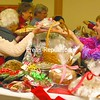 Joanne Knowlton of Plattsburgh enjoys a laugh while buying holiday desert goodies from Angela Snook during the Christmas Tea and Bazaar at Plattsburgh First Presbyterian Church Fellowship Saturday afternoon. The annual holiday event is a church fundraiser for missions projects at home and abroad. The event included baked goods, crafts, wreaths, a boutique shop, a white elephant sale and a book sale.<br><br>(P-R Photo/Andrew Wyatt)