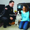 Plattsburgh City Police Lt. Scott Beebie and his wife, Lisa, are adjusting to life with a new addition to their family. Odie, an abused hound, was seized by City Police during a case of animal cruelty earlier this year and was later adopted by the Beebies. The dog's former owner recently pleaded guilty to animal cruelty and has been sentenced to probation and restitution.<br><br>(Staff Photo/Kelli Catana)
