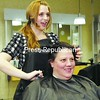 Hairstylist Elizabeth Stanley trims Cheryl Habunde's hair at Supercuts in Plattsburgh. This time of year, hairstylists, paper carriers, wait staff and other service workers receive much-needed tips.<br><br>(P-R Photo/Gabe Dickens)