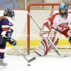 Jordyn Clothier of St. Lawrence bursts in on Saranac Lake goalie Erin Urquhart in the first period Wednesday. Urquhart posted a shutout as the Red Storm won 3-0.<br><br>(P-R Photo/Pat Hendrick)