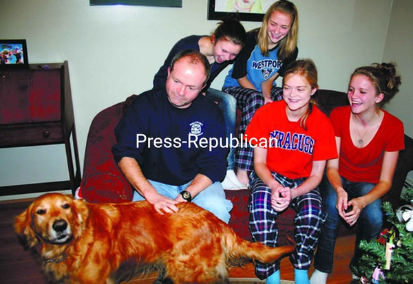 Ben Sudduth (sitting, left to right), Molly Rascoe and Mallory Sudduth; and Megan Sudduth (back, left to right) and Emily Rascoe share a laugh with Maggie the dog. Ben and Molly are both recovering after Ben  donated one of his kidneys to the Westport teenager.<br><br>(Staff Photo/Alvin Reiner)