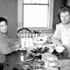 Kristin and Mark Kimball sit at their farmhouse table dining on the food that they have grown.<br><br>(P-R Photo/Alvin Reiner)