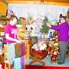 Gen Gero and her 11-year-old granddaughter, Morgan Lamica, share a laugh as they get into the holiday spirit while setting up holiday items at the Christmas Bear gift shop in Burke. Many of the items in the shop are handmade by Gero and her family.<br><br>(P-R Photo/Joanne Kennedy)