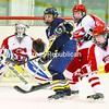 Brenna Whitney of Lake Placid attempts to tip a flying puck past Saranac Lake goalie Katey Snyder as Shannon Muldowney (right) and Jane Swartz reach in to lend a hand. The Tri-Lakes rivals played to a 1-1 tie with both goaltenders brilliant. No details were reported.  <br><br>(P-R Photo/Pat Hendrick)