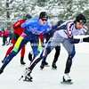 Racers churn through the laps of a speed-skating event Saturday at the Olympic Oval in Lake Placid. It was the first day of competition in a variety of age groups and distances. The races will continue today.<br><br>(P-R Photo/Pat Hendrick)