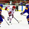 Plattsburgh State's Kate Fairfield brings the puck in against Elmira defensemen Ella Stewart (22) and Amanda Ritzel (8). The Cardinals beat the Soaring Eagles for a weekend split.<br><br>(P-R Photo/Gabe Dickens)