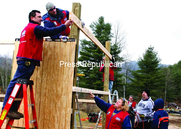 Volunteers work to build a shelter for Pops, a horse who was once abused. The shelter was constructed through Lowe's Heroes program at Crane Mountain Valley Horse Rescue in Westport. Joni Carr-Barcomb of Plattsburgh (fourth from right) got the project rolling. <br><br>(Staff Photo/Alvin Reiner)