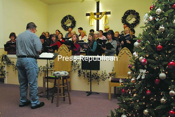 """George Slosson leads a choir rehearsal for the Christmas cantata """"O Holy Night."""" The free public performance will be held at 6 p.m. Sunday at the Plattsburgh Church of the Nazarene, located at 187 Broad St.<br><br>(P-R Photo/Gabe Dickens)"""