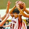 While battling for a rebound in the first half, Saranac Lake's Jazzmyn Tuthill finds herself double-teamed by Allie Carter (left) and Kayla Dragoon of Northeastern Clinton in CVAC basketball Tuesday night in Saranac Lake. The visiting Cougars went on to a 61-25 triumph.<br><br>(P-R Photo/Pat Hendrick)