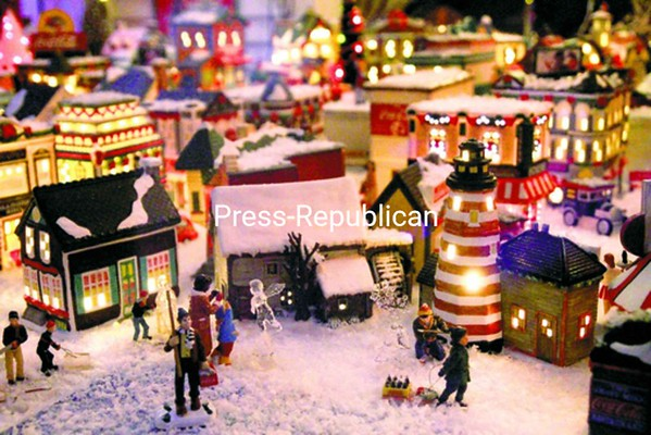 A detail of the Christmas community shows people creating ice sculptures in a village square.<br><br>(P-R Photo/Gabe Dickens)