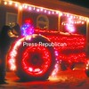 Dan Boire of Beekmantown adjusts Christmas lights on his 1956 Farmwell tractor Wednesday evening. Boire said that neighbors look forward to his Christmas yard display. He spent several hours one recent Sunday placing the lights on the fully functioning tractor.<br><br>(P-R Photo/Andrew Wyatt)