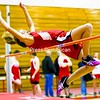 Saranac's Sabrina Bruno clips the bar as she attempts to clear 4 feet, 4 inches in the high jump during Wednesday's Champlain Valley Athletic Conference indoor track and field meet at the Plattsburgh State Field House.<br><br>(P-R Photo/Gabe Dickens)