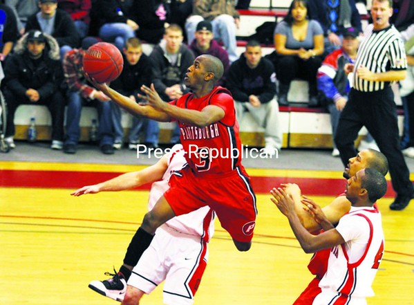 Plattsburgh State's Carl Munnerlyn (3) breaks through Oneonta's defense for a layup in the second half of a SUNYAC men's basketball game at Memorial Hall Saturday. The Cardinals won, 69-60.<br><br>(P-R Photo/Gabe Dickens)