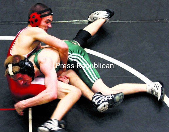 Saranac's Michael Phillips and Beaver River's Leo Tabolt (striped singlet) look for control of their opponent during Saturday's Saranac Early Bird Wrestling Tournament. Tabolt won the match and eventually lost in the final at 135 pounds. Phillips finished fourth.<br><br>(P-R Photo/Gabe Dickens)