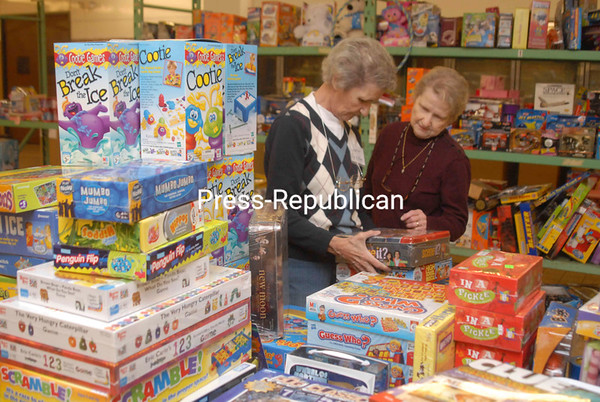 Janet Labombard (left) and Joan Parker volunteer to inventory and display toys Friday afternoon at the Christmas Bureau in Plattsburgh. The Christmas Bureau annually collects donated and new household goods, clothes and toys to distribute to needy families during the holiday season. Located in the Plattsburgh Plaza on Cornelia Street, the bureau is open Monday through Saturday 10 a.m. to 4 p.m. For more information about the volunteer effort, call 562-1253.<br><br>(P-R Photo/Andrew Wyatt)