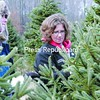 Morrisonville residents Erica Erickson (left) and Missy LaClair take a closer look at a tree at the Covel Tree Farm and Nursery in Peru.<br><br>(P-R Photo/Gabe Dickens)