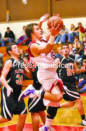C.J. Stewart of Saranac Lake outruns three Plattsburgh defenders to the basket in the third quarter Friday night. Plattsburgh High went on to defeat the host Red Storm 65-56.<br><br>(P-R Photo/Pat Hendrick)