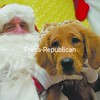 Adrienne, a three-month-old golden retriever, enjoys a moment sitting on Santa's lap at Tails of the Adirondacks pet store in Plattsburgh. The store each year invites people to bring pets in to be photographed with the jolly 'ol elf. The event is a fundraiser to help the Adirondack Humane Society cover operating expenses. Many pet owners say they will be giving their animals Christmas presents.<br><br>(P-R Photo/Andrew Wyatt)
