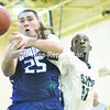 There's no winner in this rebounding battle, as the ball squirts away from Jesse Gates of Onondaga CC (left) and Randy Danso of North Country CC during a men's basketball game Sunday in Saranac Lake. The Saints won 103-87.<br><br>(P-R Photo/Pat Hendrick)