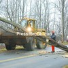 First Class Line Mechanic Dave Brelia of New York State Electric and Gas cuts a tree that had fallen across Kent Falls Road in Morrisonville Wednesday afternoon. High wind gusts associated with a powerful storm moving through the North Country blew over the tree, which temporarily blocked traffic and landed on power lines along the road.<br><br>(P-R Photo/Andrew Wyatt)