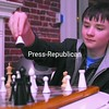 Jeremy Davies, 12, of Plattsburgh takes on his father in a chess game at the Koffee Kat in Plattsburgh last week. Davies recently placed third in the 41st Chess Congress tournament, which included contestants from six states. It was his first time entering a tournament.<br><br>(P-R Photo/Andrew Wyatt)